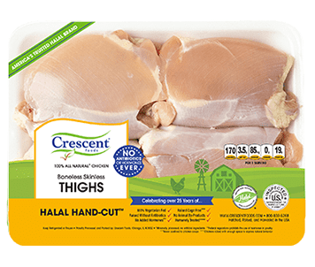 Crescent Foods chicken thighs in a colorful yellow and green packaging.
